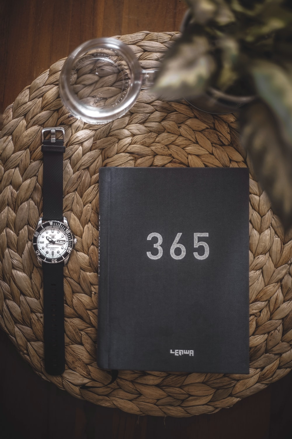 round black 365 analog watch with box