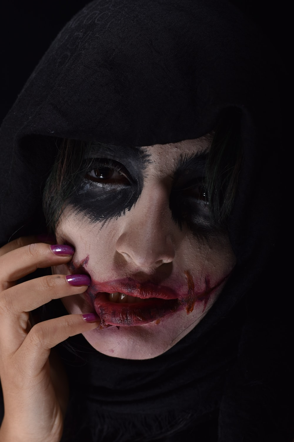woman with black and white paint face