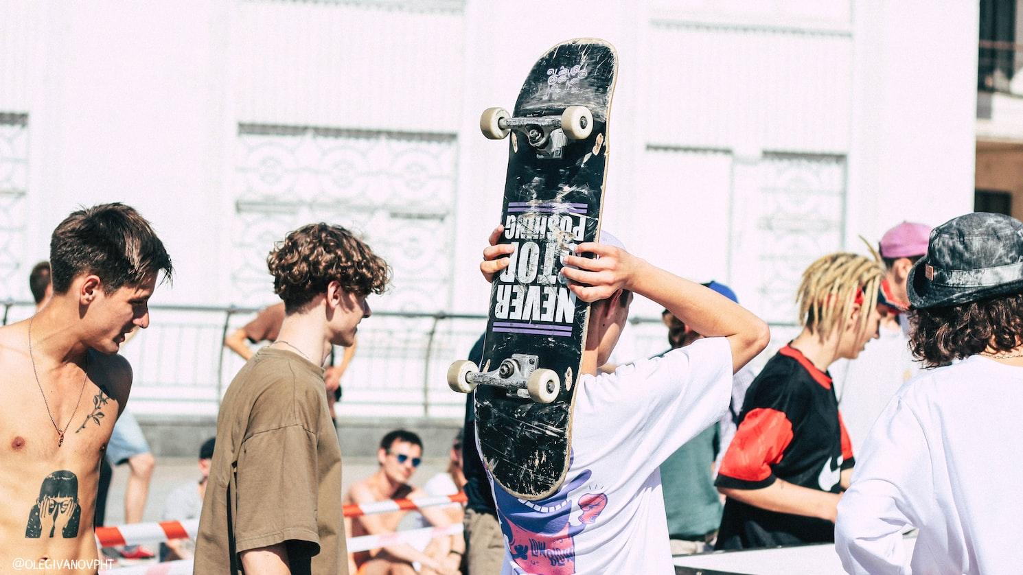 men and skateboard