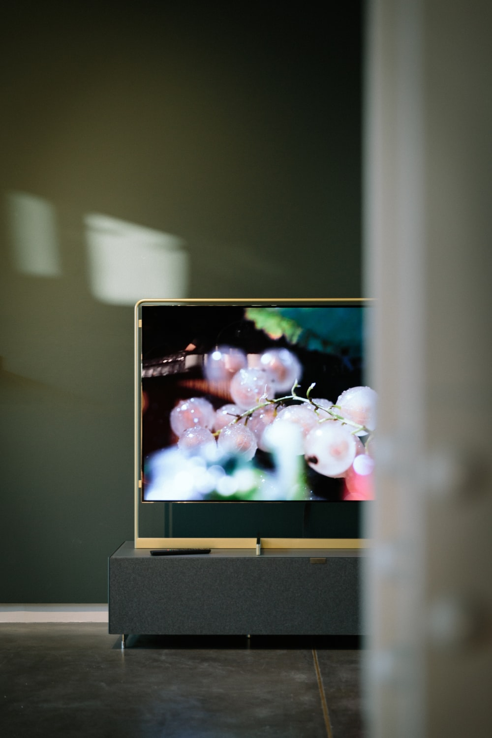 TV displaying cherries