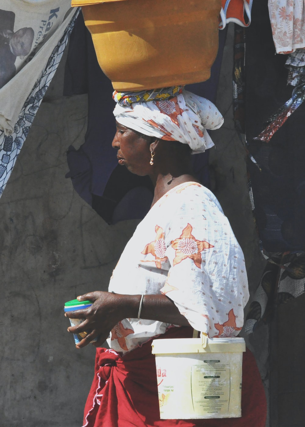 woman carrying bucket