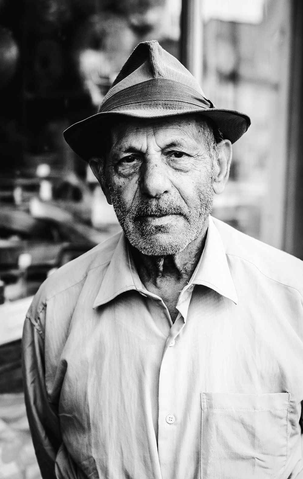 grayscale photography of man wearing dress shirt