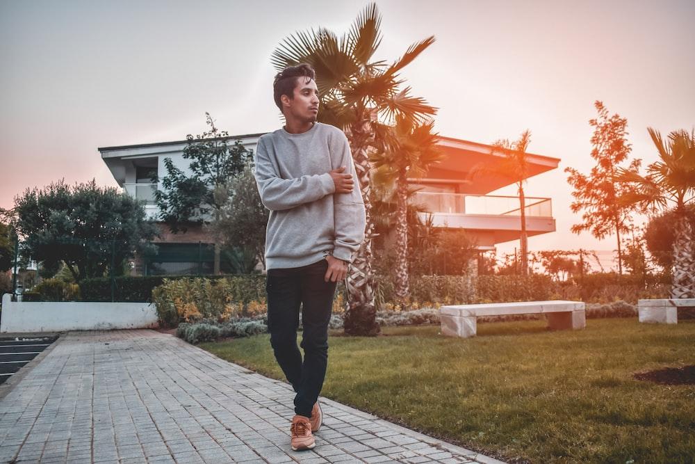 man walking on pathway during golden hour