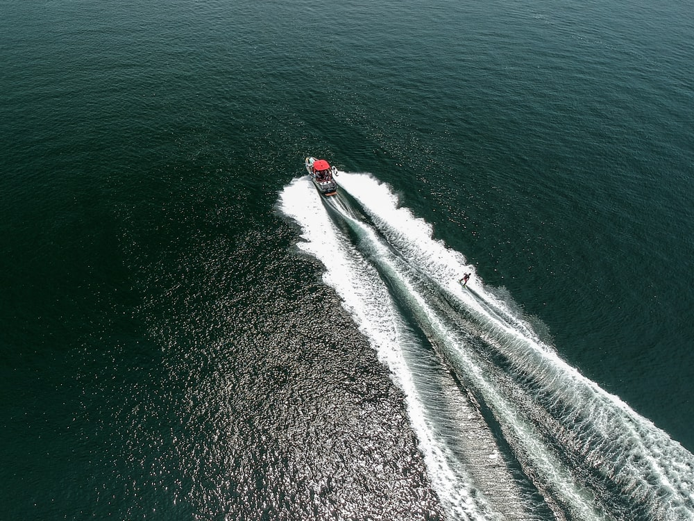 aerial photography of speedboat on body of water