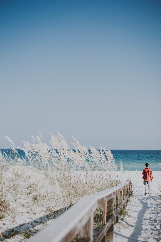 man standing near seashore during daytime