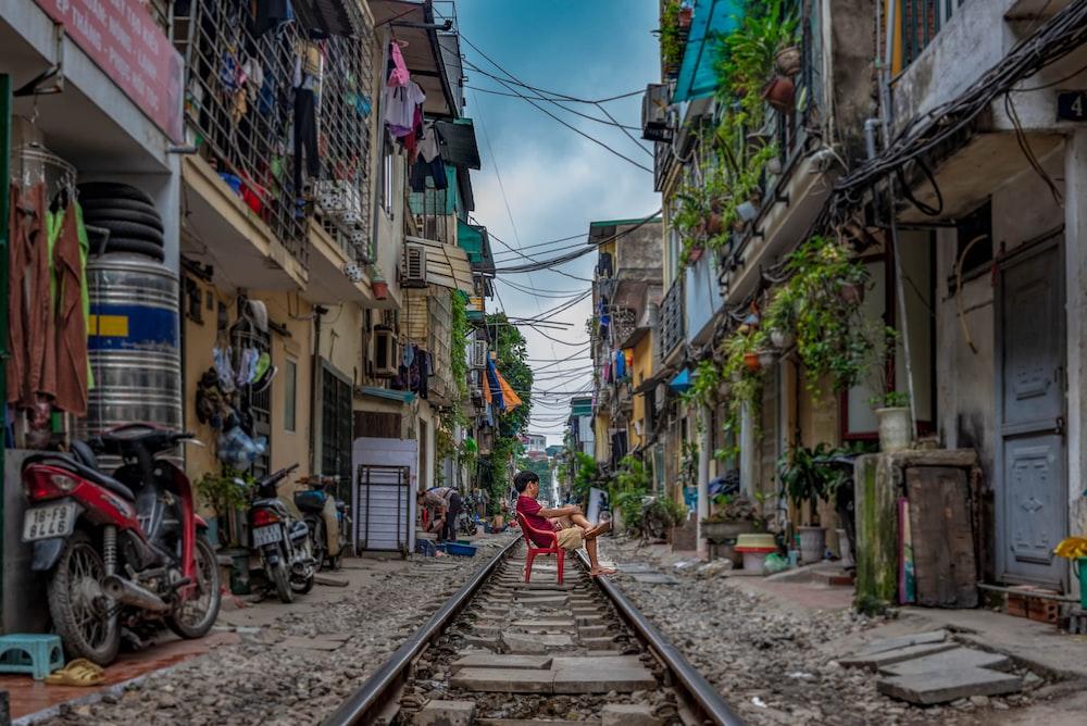 man sitting on railway
