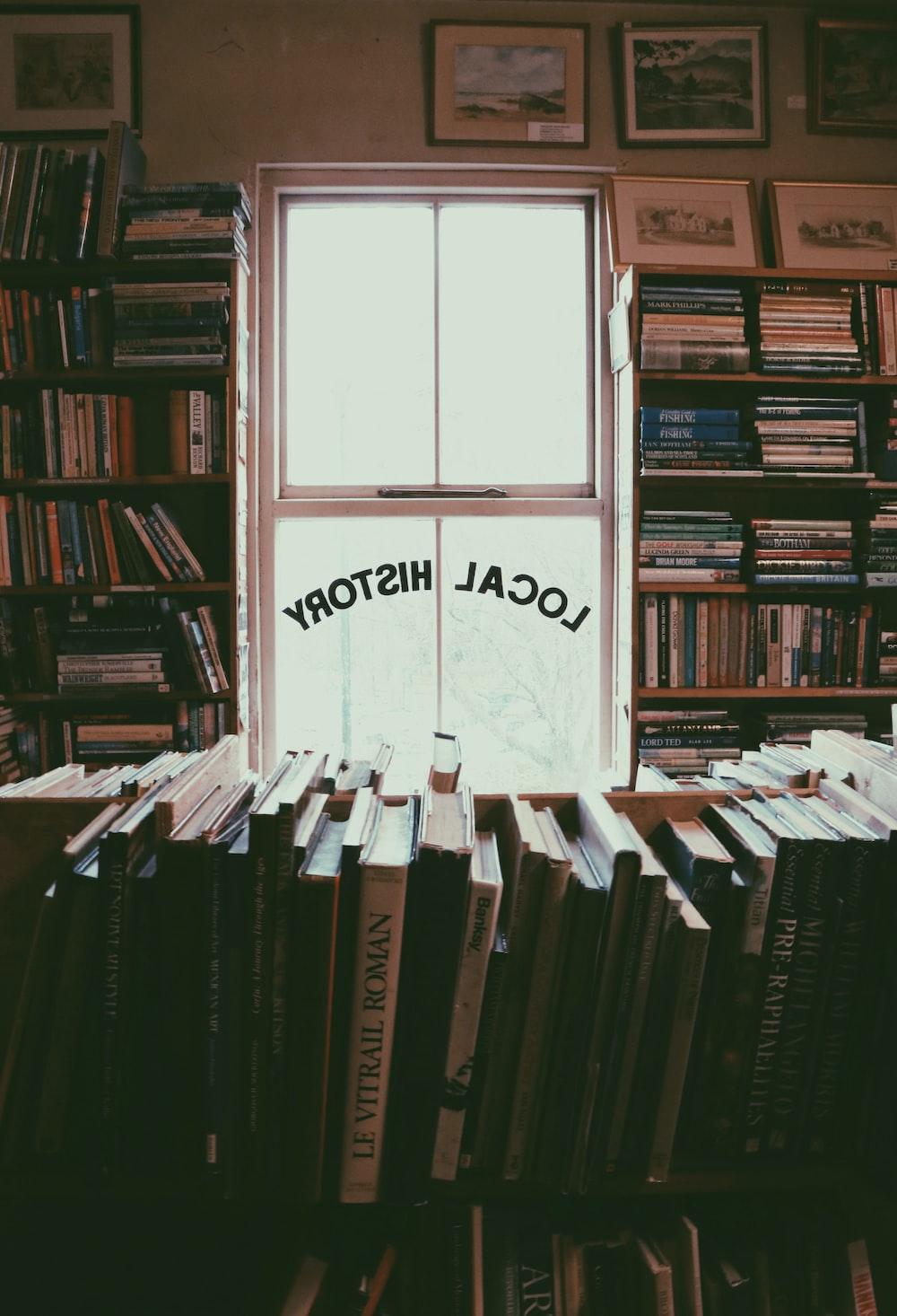 assorted-title book lot on rack inside room