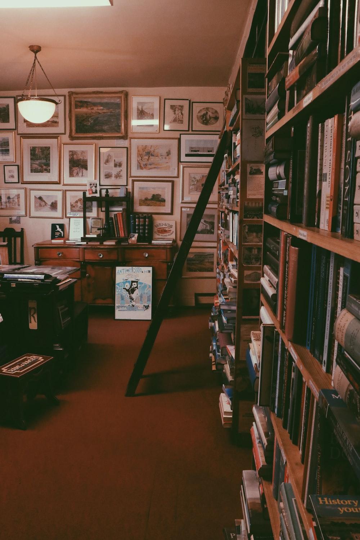 black ladder beside book shelf