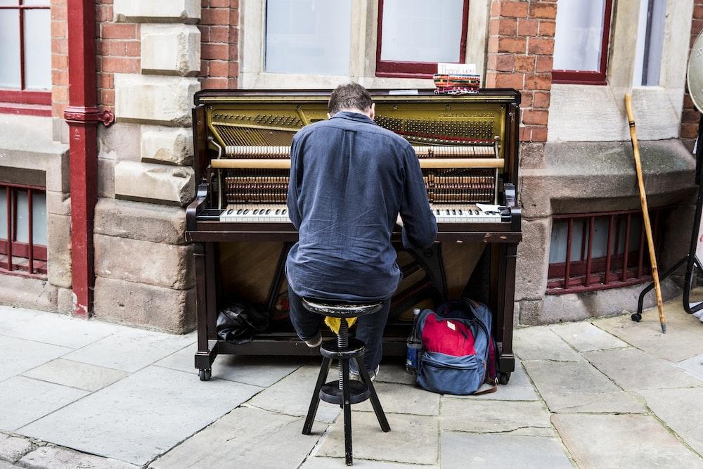 man performing piano