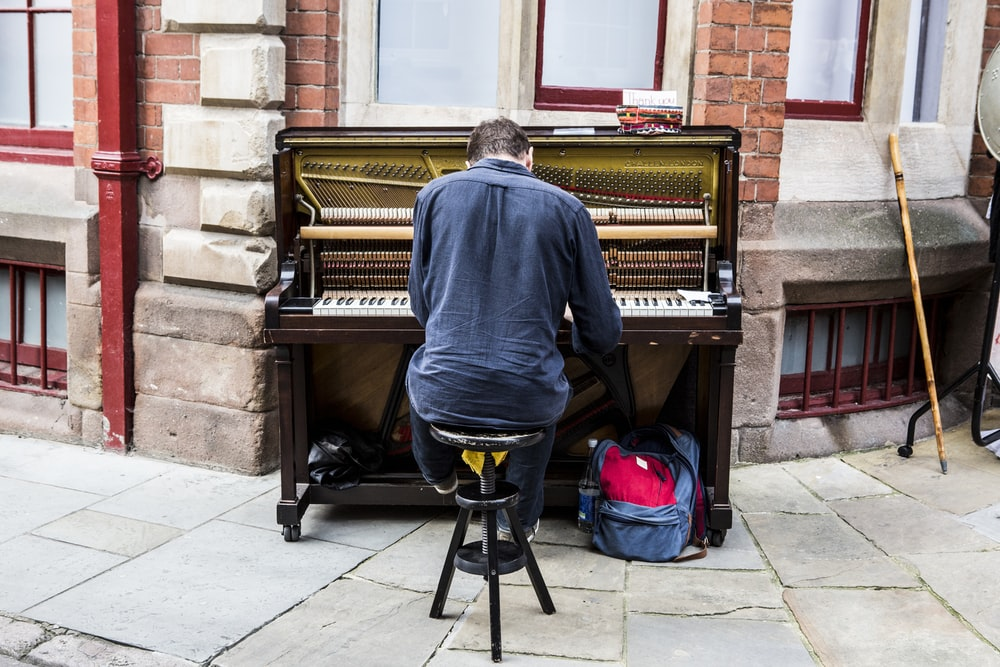 man performing piano
