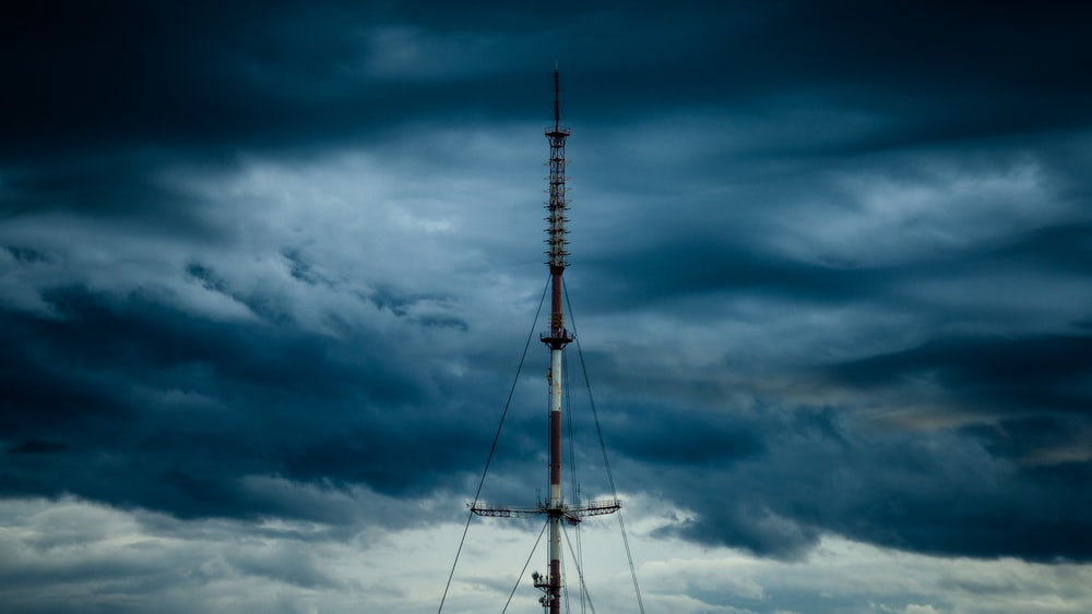 tower under cloudy sky at daytime