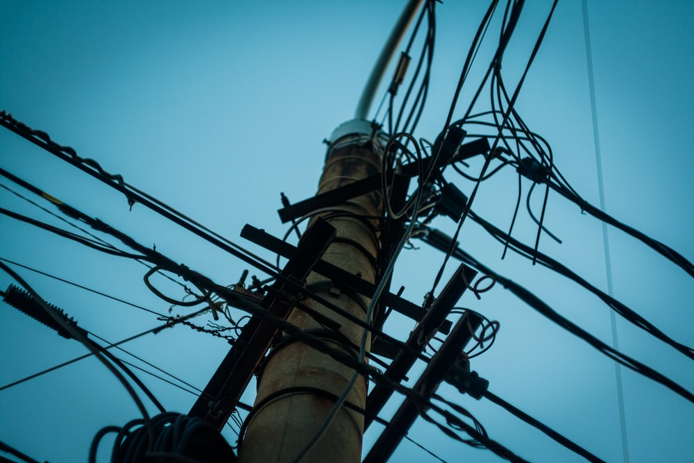 low angle photography of utility tower