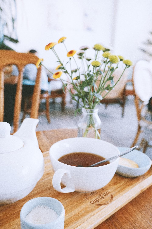 white ceramic teacup beside white teacup