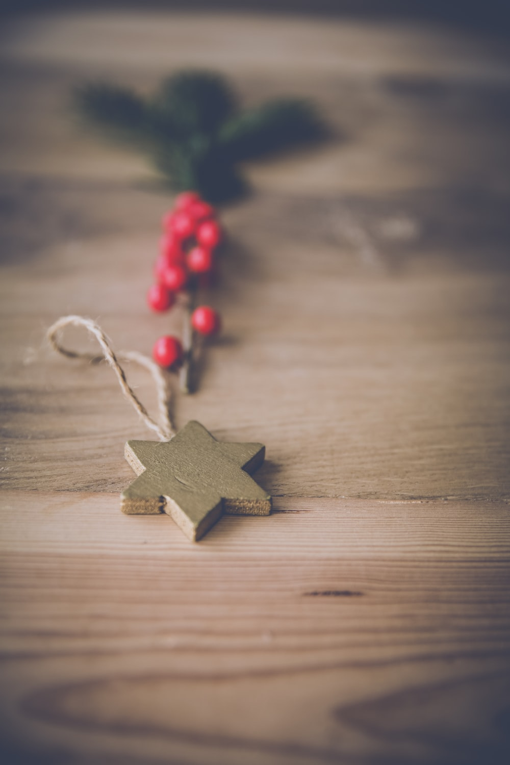 selective focus photography of star pendant