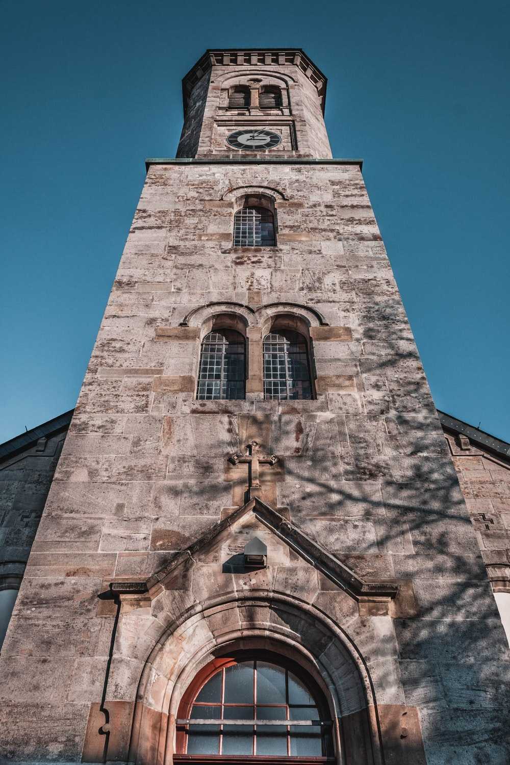 low-angle photography of brick cathedral