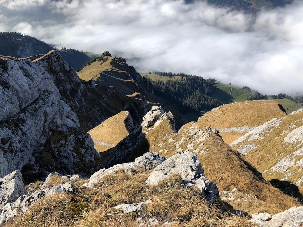 mountain range under foggy weather during daytime