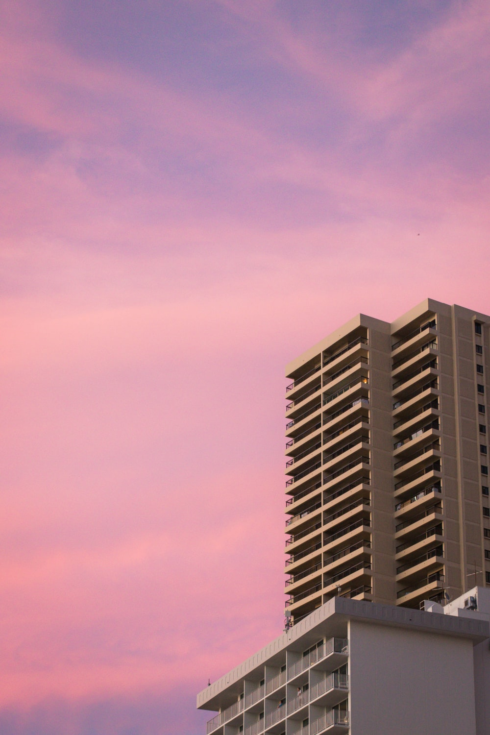 concrete building during sunset