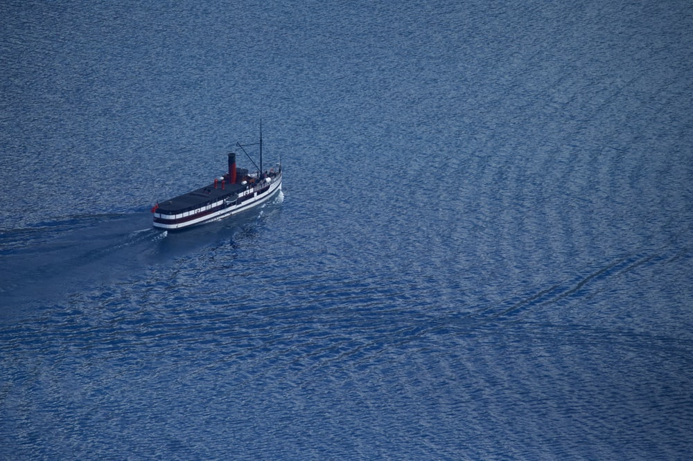 aerial photography of sailing ship in blue ocean