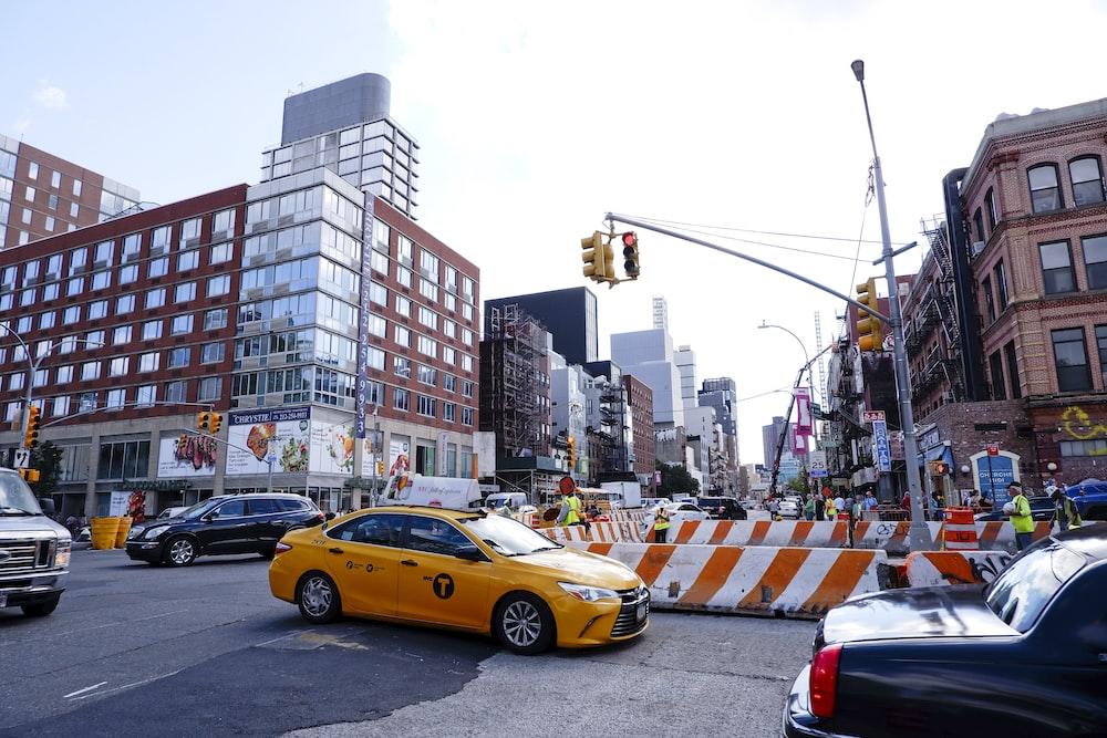 yellow sedan on asphalt road