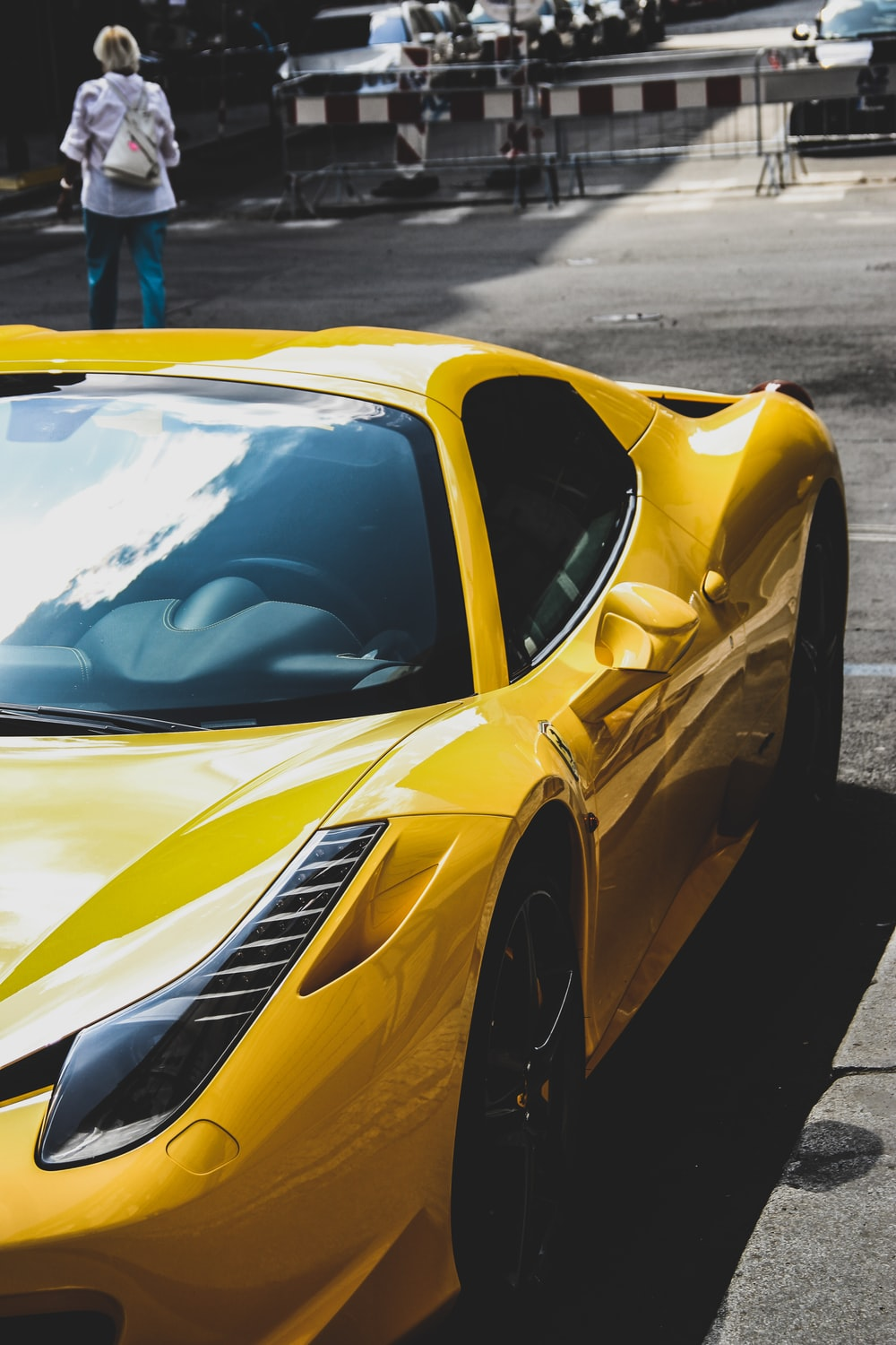 yellow Ferrari 458 Italia on road