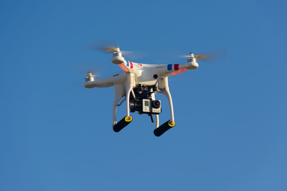 white and red drone