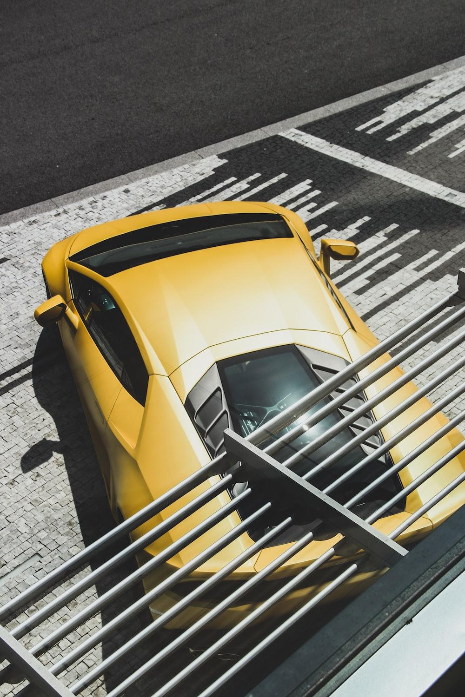 yellow and black Lamborghini coupe