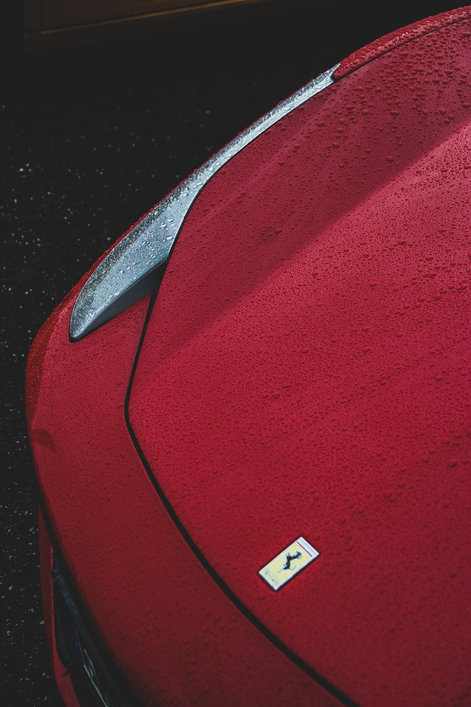 red Ferrari sports coupe