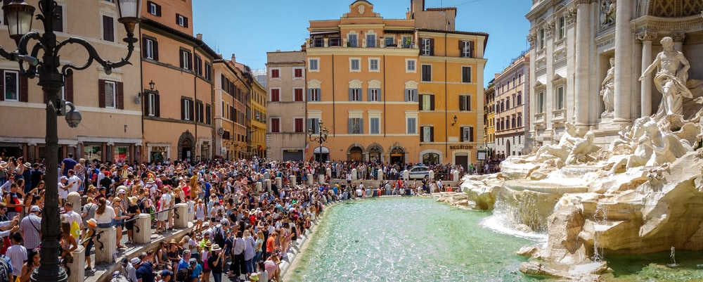 crowd of people gathered in front of Trevi Fountain