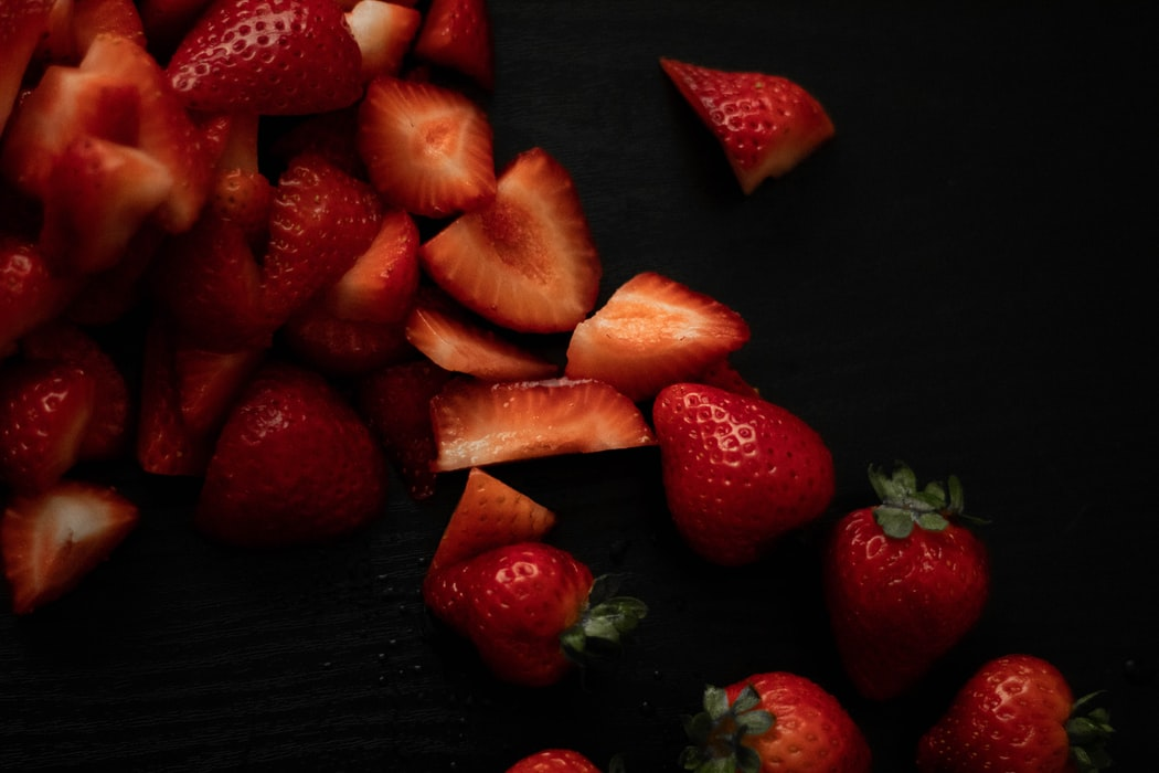 strawberries on a black background