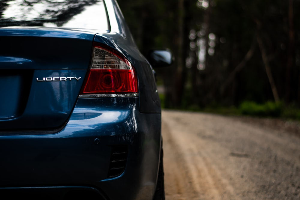 close up photography of Subaru Liberty sedan during daytime