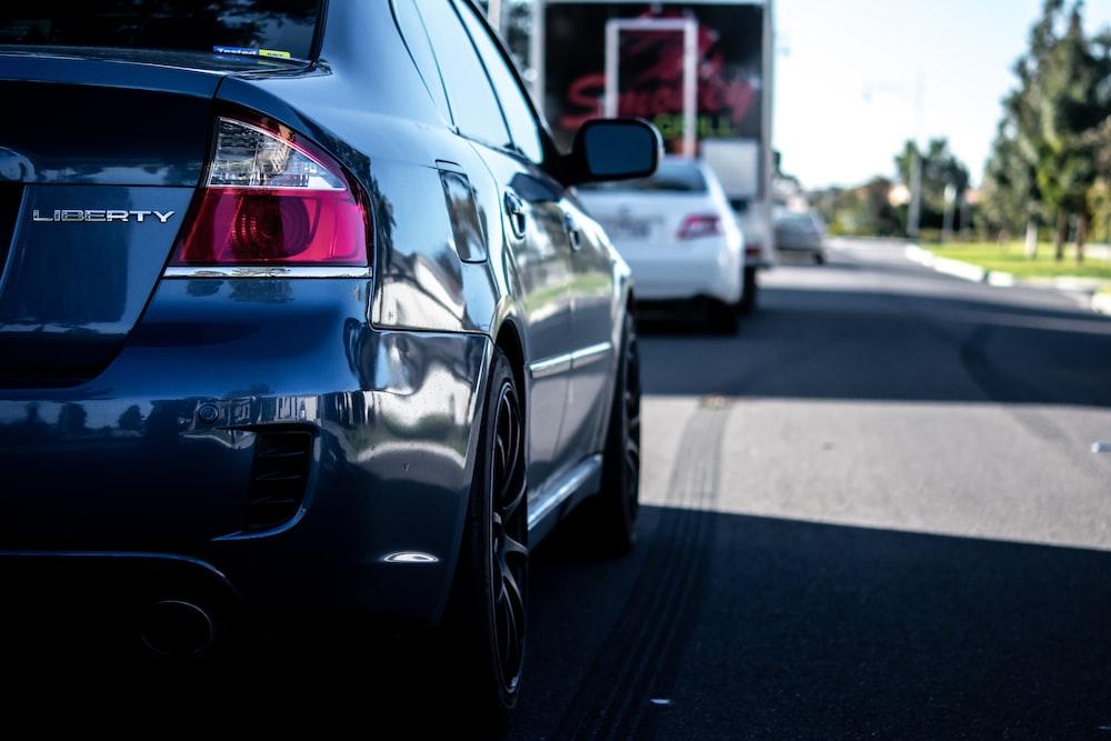 shallow focus photo of black sedan