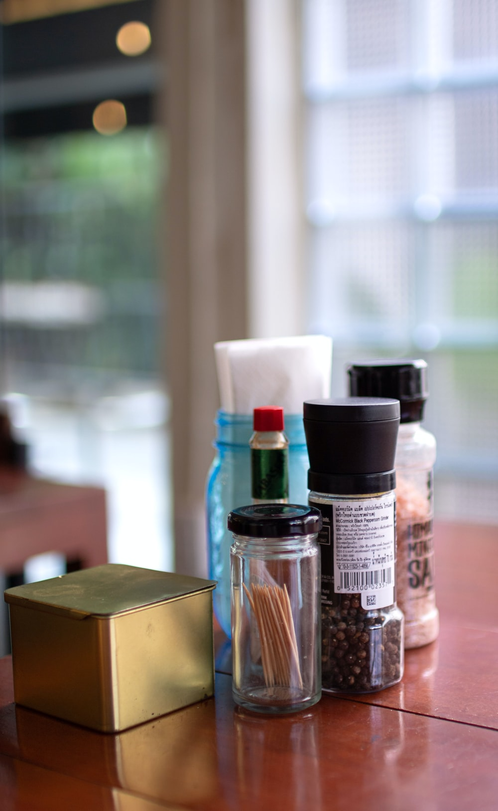 bokeh photography of condiment shakers