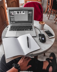 silver MacBook Air displaying Adobe file