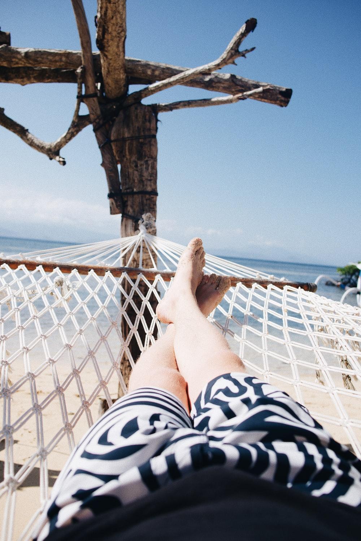 person on hammock near sea