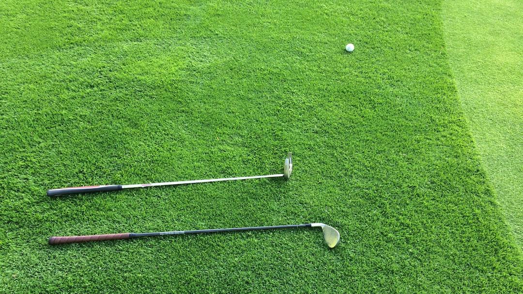 Golf club laying on green
