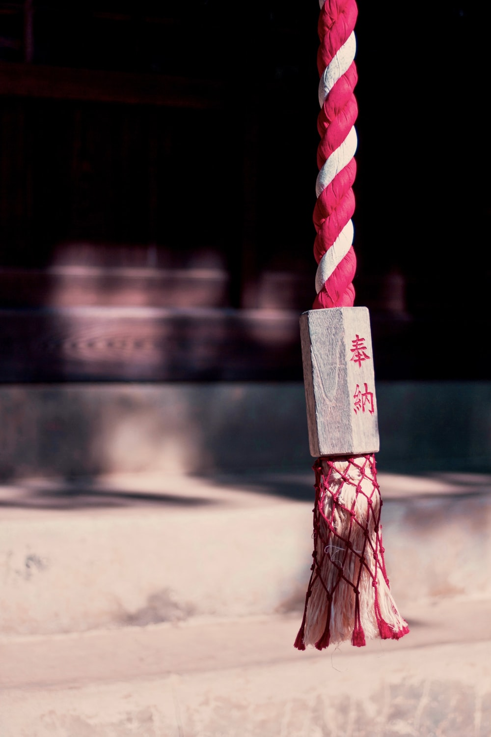 selective focus photography of white and pink rope