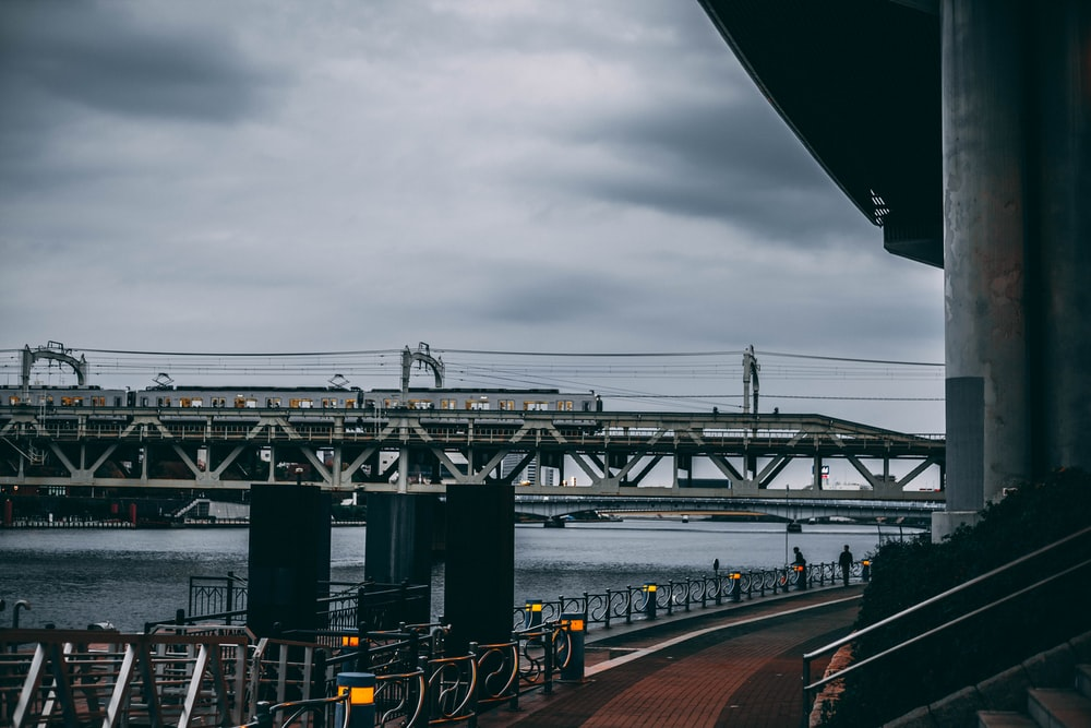 train on track at shore under gray sky