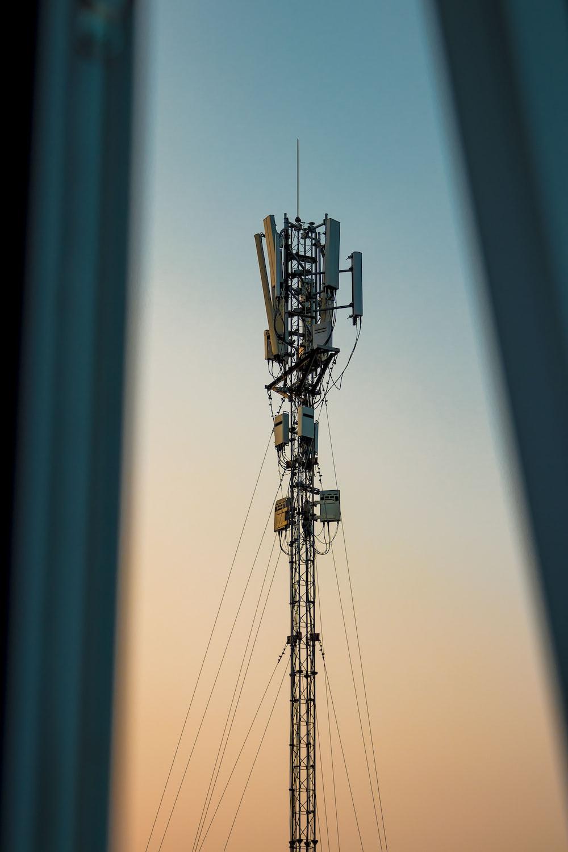 grey metal tower during daytime