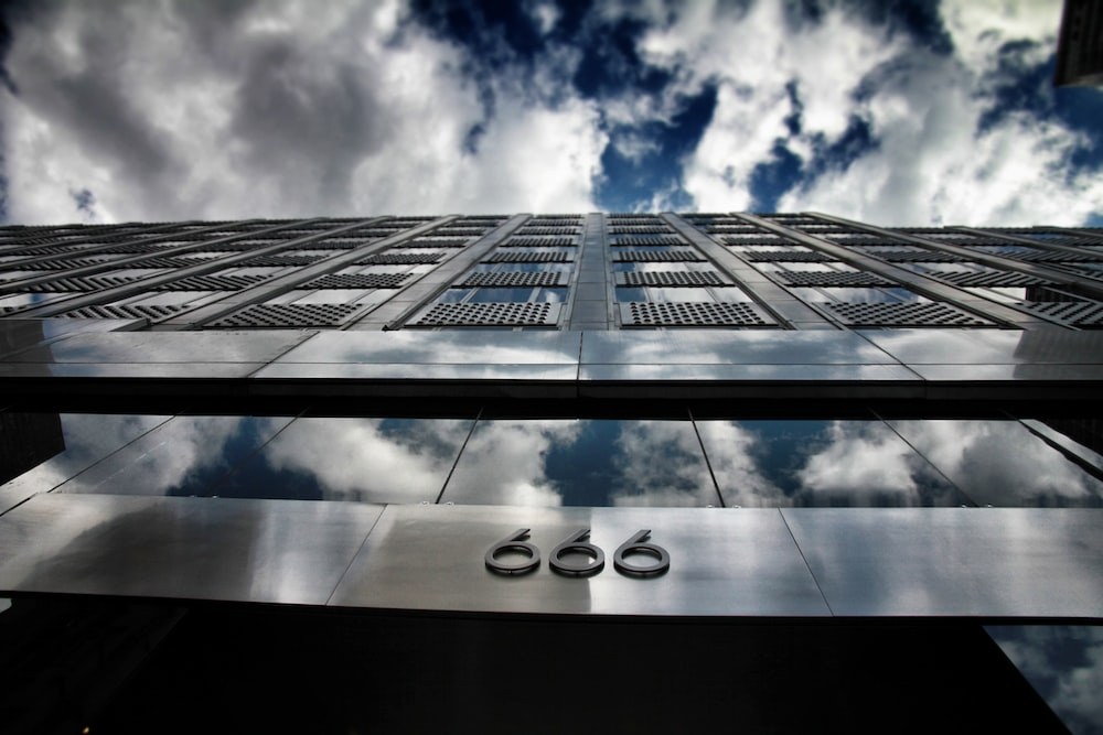 low-angle photography of 666 building