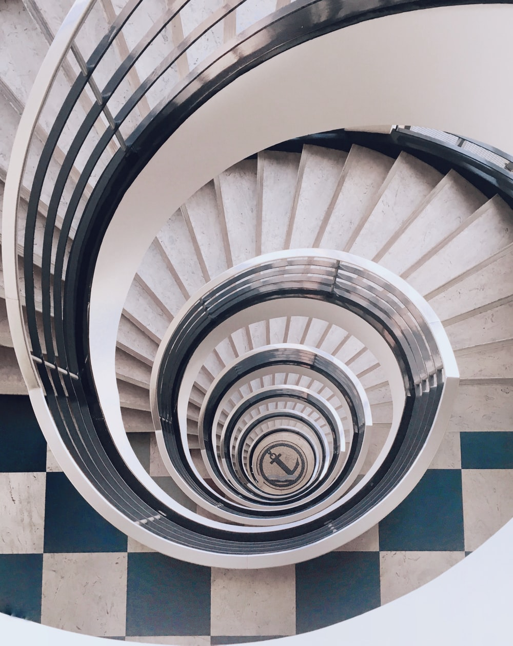 white and gray spiral stairs with no people