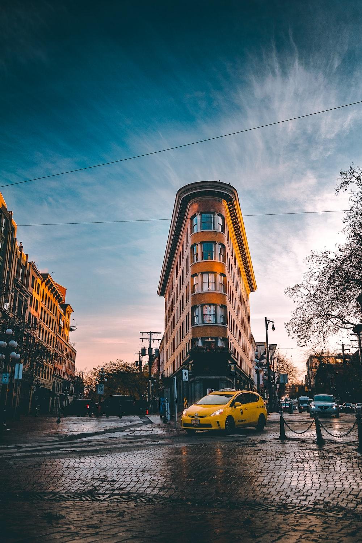 selective focus photography of yellow car