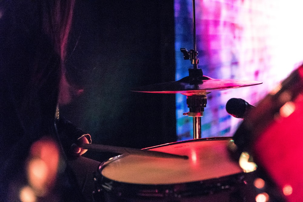 person playing drums