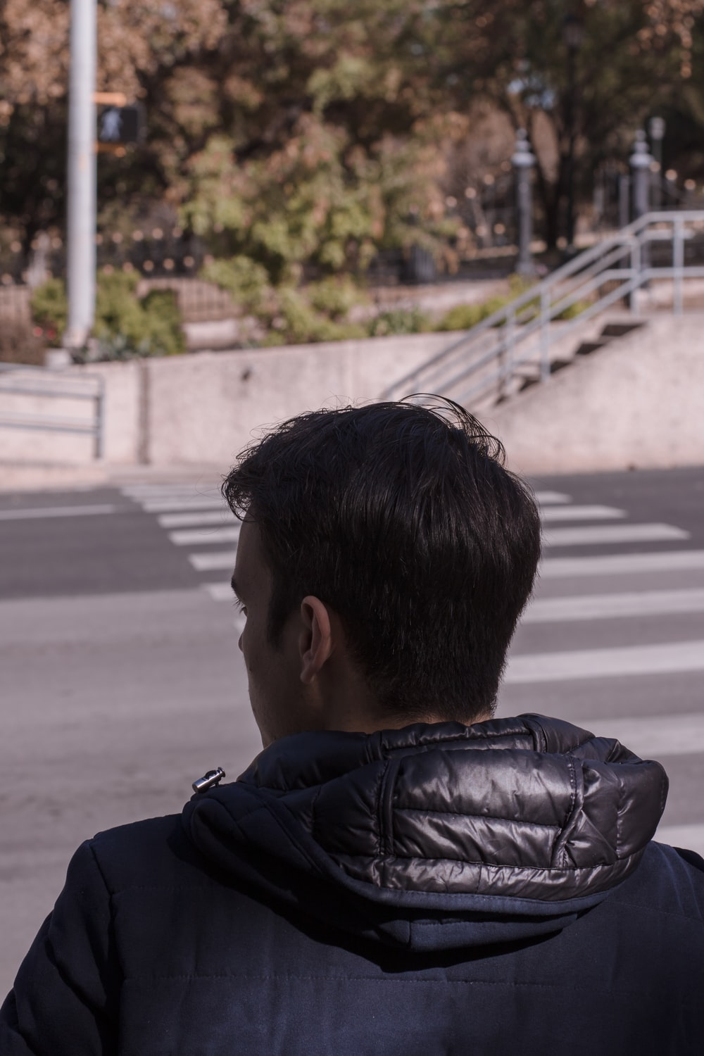 man standing in front of road