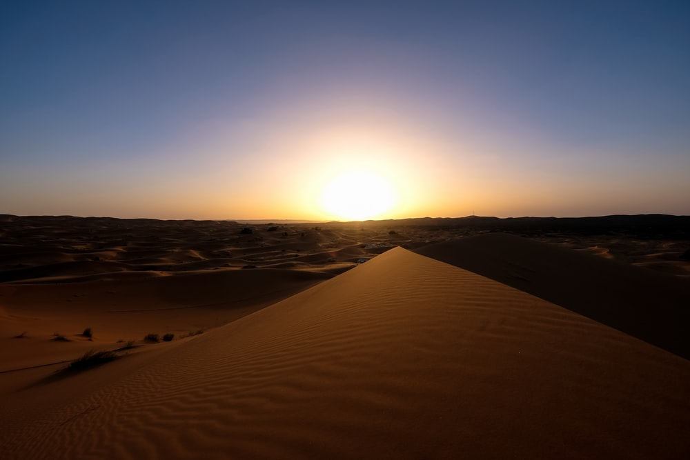 landscape photography of sand during sunset