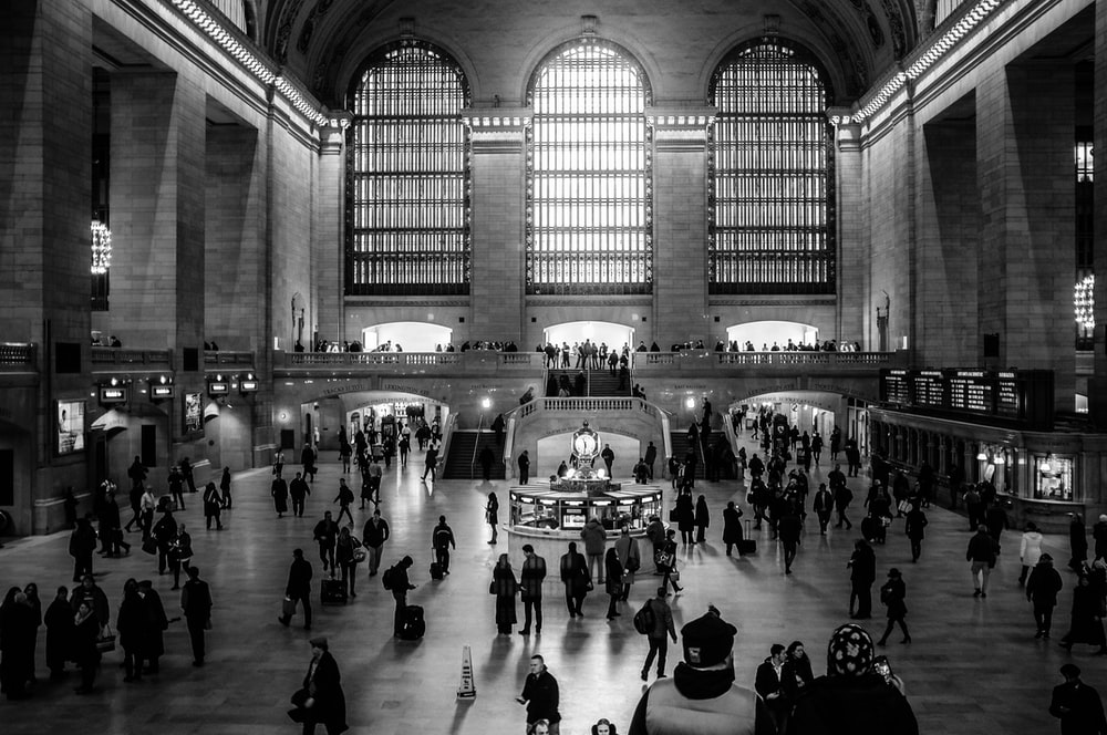grayscale photography of people in structure