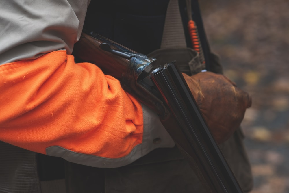 selective focus photography of person reloading rifle