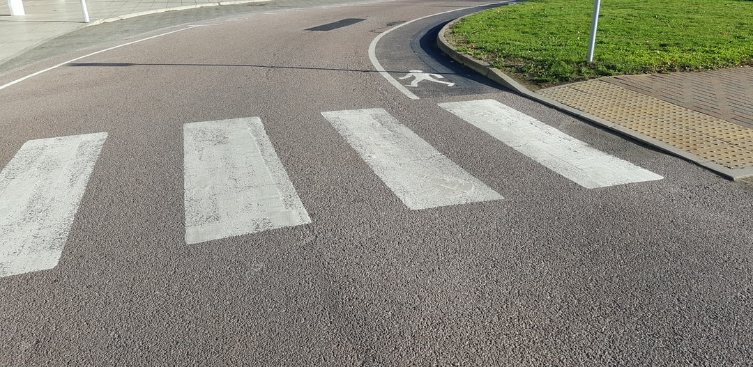 Pedestrian crossing with extra on-road walking to a bus stop. Just something captured you don't see everyday.