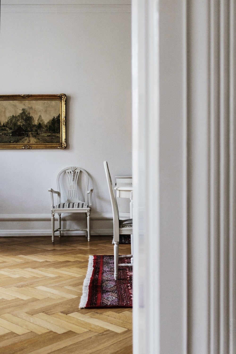 empty armchair by wall near dining table