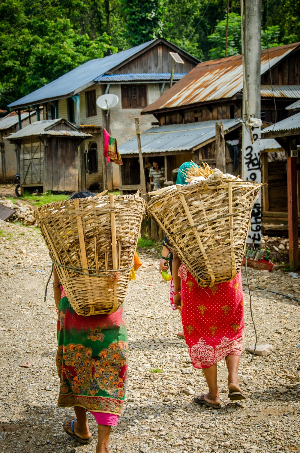 two people carrying baskets