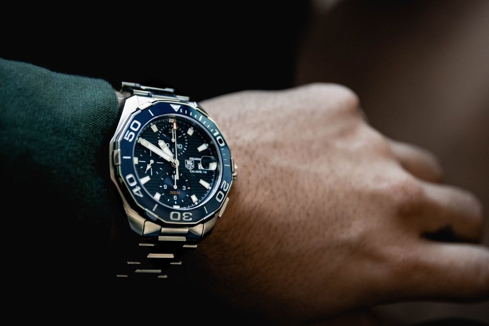 round black chronograph watch at 5:50